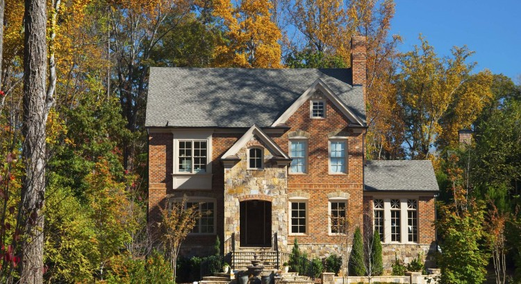 A brick house in Atlanta with a look like it's in the woods, characteristic of the look of northern Atlanta.